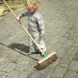 26452837 - boy holding a broom